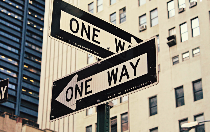 Two one-way signs