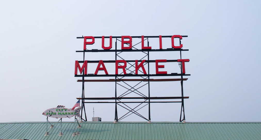Public market sign on top of roof