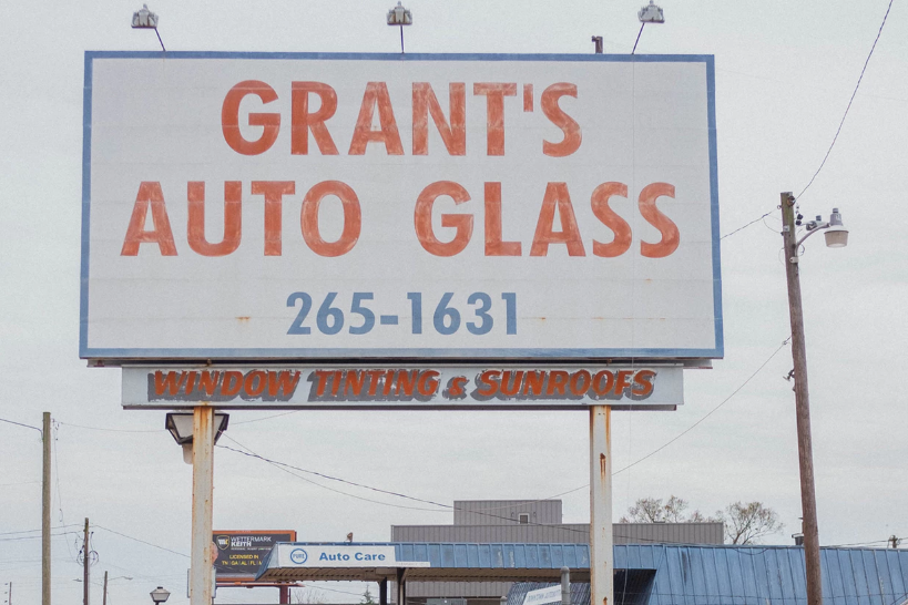Auto glass ad sign