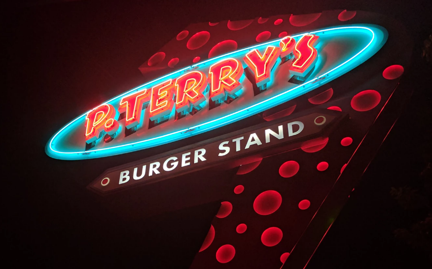 Neon burger ad sign