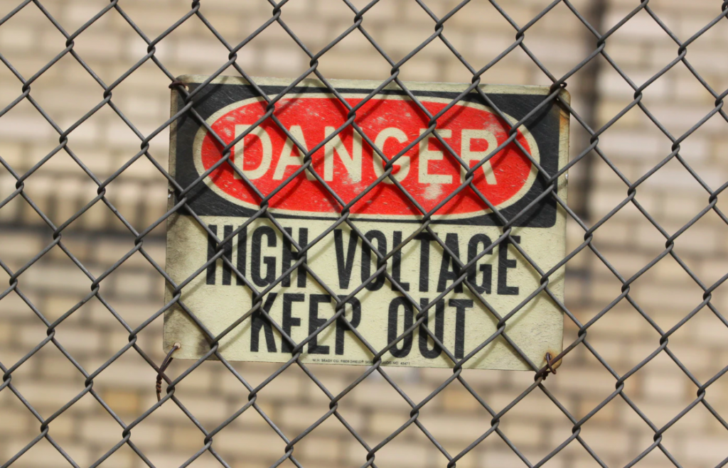 Danger sign on fence