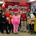 Signarama staff dressed up for a Halloween party