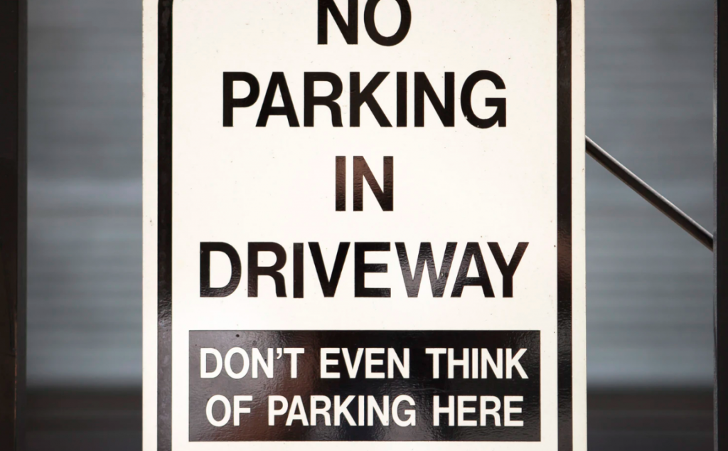 No parking sign with humor